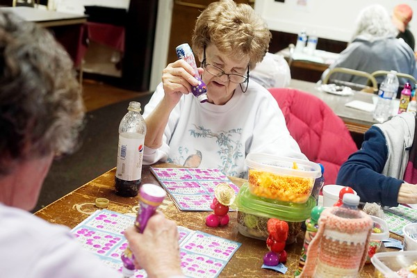 BEN GARVER — THE BERKSHIRE EAGLE<br /> Laura Brown scans her card as the numbers are called during bingo night at the Hinsdale Lions Club.