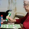 BEN GARVER — THE BERKSHIRE EAGLE<br /> Alice Liebenow fills out a bingo card on a Tuesday night at the Hinsdale Lions Club.