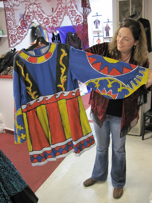 . Berkshire Costume Company owner Kara Demler shows off a vintage plain blue tunic painted with fabric paint to transform it into a royal garment. Jenn Smith/Berkshire Eagle Staff Oct. 18, 2013