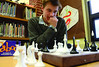 Artem Dudko, 14, play a game of chess with his dad Sergiy at the Williamstown Public Library during a game day, and arts and crafts activity on Friday, Dec. 27, 2013. (Gillian Jones/North Adams Transcript)