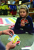 Noelle Dravis, 8, plays the card game UNO with Williamstown Public Library's Children's Assistant Helen Olshever during a game day, and arts and crafts activity on Friday, Dec. 27, 2013. (Gillian Jones/North Adams Transcript)