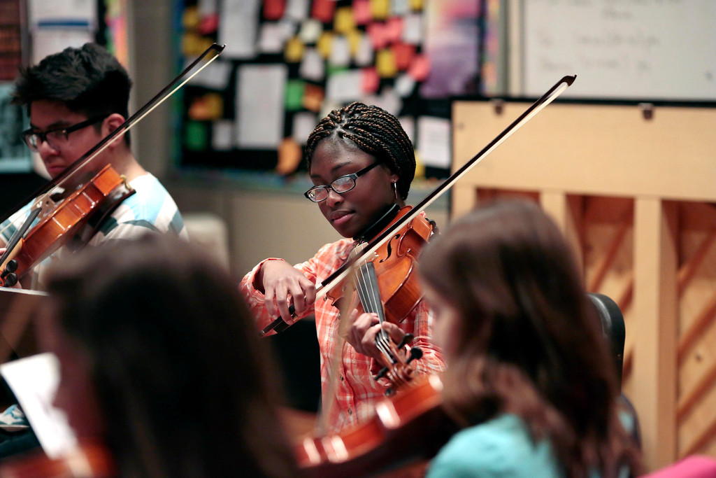 . Olivia Nda is one of six students at Herberg Middle School to receive musical instruments from the Domenic A. Izzi Jr. Foundation for Young Aspiring Musicians. Thursday, April 3, 2014. Stephanie Zollshan / Berkshire Eagle Staff / photos.berkshireeagle.com