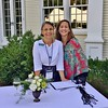 Berkshire Botanical Gardens Director of Marketing and Communications Robin Parow  and Office Manager Elizabeth Veraldi greet guests as they arrive for the <br /> Fête des Fleurs at Broad Meadows. Janel Harrison — Special to the Eagle