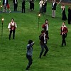 """Actors perform a fight scene from """"Romeo and Juliet"""", as guests walk the path en route to dinner."""