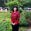 Robin Gerson Wong, of Seven Hills Inn, grabs a moment in the garden.