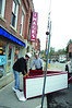 Callahan Sign Company installs a marquee  to be put below the Images Cinema sign, above the front door, on Spring Street in Williamstown on Friday, Dec. 6, 2013. (Gillian Jones/North Adams Transcript)