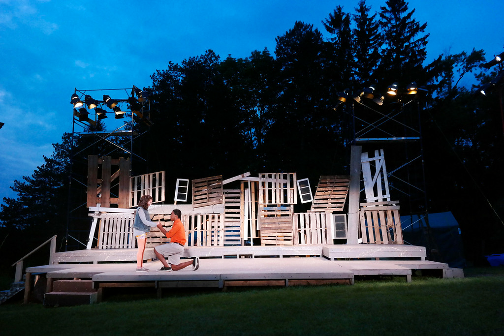 . Julie Castagna as Hermia and Julius Reese as Lysander rehearse on the Outdoor Stage in Springside Park for A Midsummer Night\'s Dreeam. Monday July 14, 2014.  Ben Garver / Berkshire Eagle Staff / photos.berkshireeagle.com