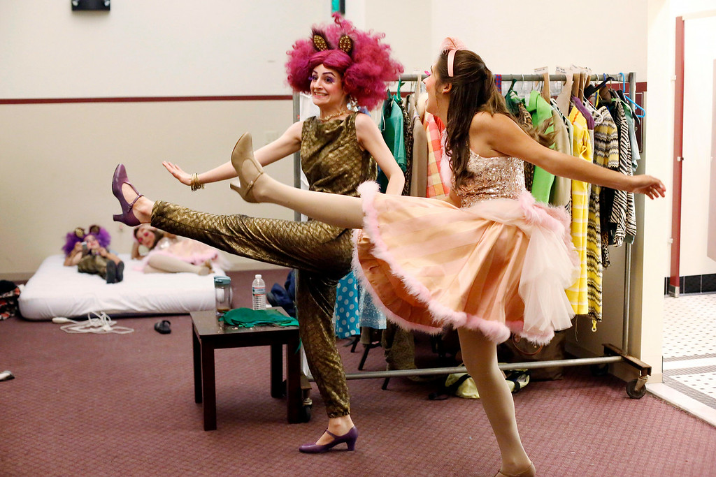 . Caroline Fairweather, left, and Hanna Koczela let off some steam with a bit of line dancing in the dressing room during intermission in the final dress rehearsal for Berkshire Theatre Group\'s performance of \'Seussical\' at the Colonial Theatre in Pittsfield. Wednesday, August 6, 2014. Stephanie Zollshan / Berkshire Eagle Staff / photos.berkshireeagle.com