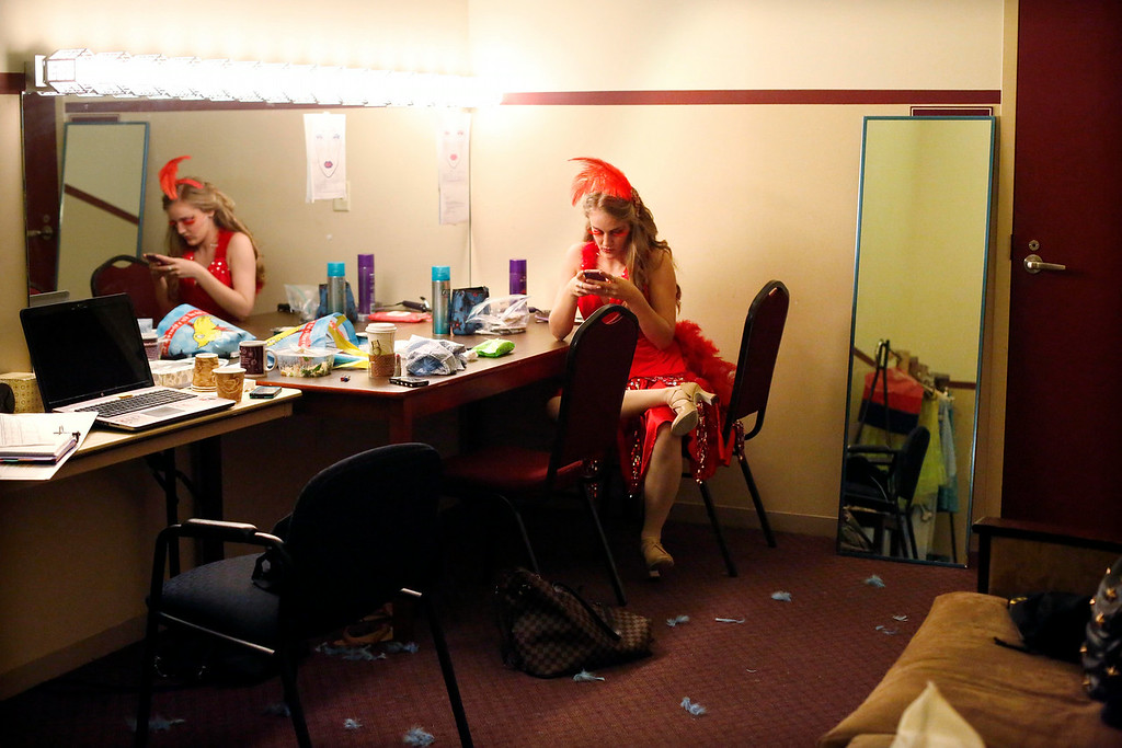. Allie Seibold, who plays Mayzie La Bird, checks her phone in her dressing room during intermission in the final dress rehearsal for Berkshire Theatre Group\'s performance of \'Seussical\' at the Colonial Theatre in Pittsfield. Wednesday, August 6, 2014. Stephanie Zollshan / Berkshire Eagle Staff / photos.berkshireeagle.com