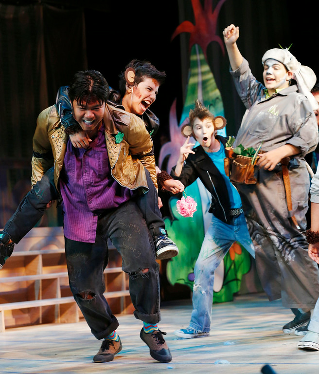 . The Wickersham Brothers, a group of troublesome monkeys, steal from Horton the elephant during a scene in the final dress rehearsal for Berkshire Theatre Group\'s performance of \'Seussical\' at the Colonial Theatre in Pittsfield. Wednesday, August 6, 2014. Stephanie Zollshan / Berkshire Eagle Staff / photos.berkshireeagle.com