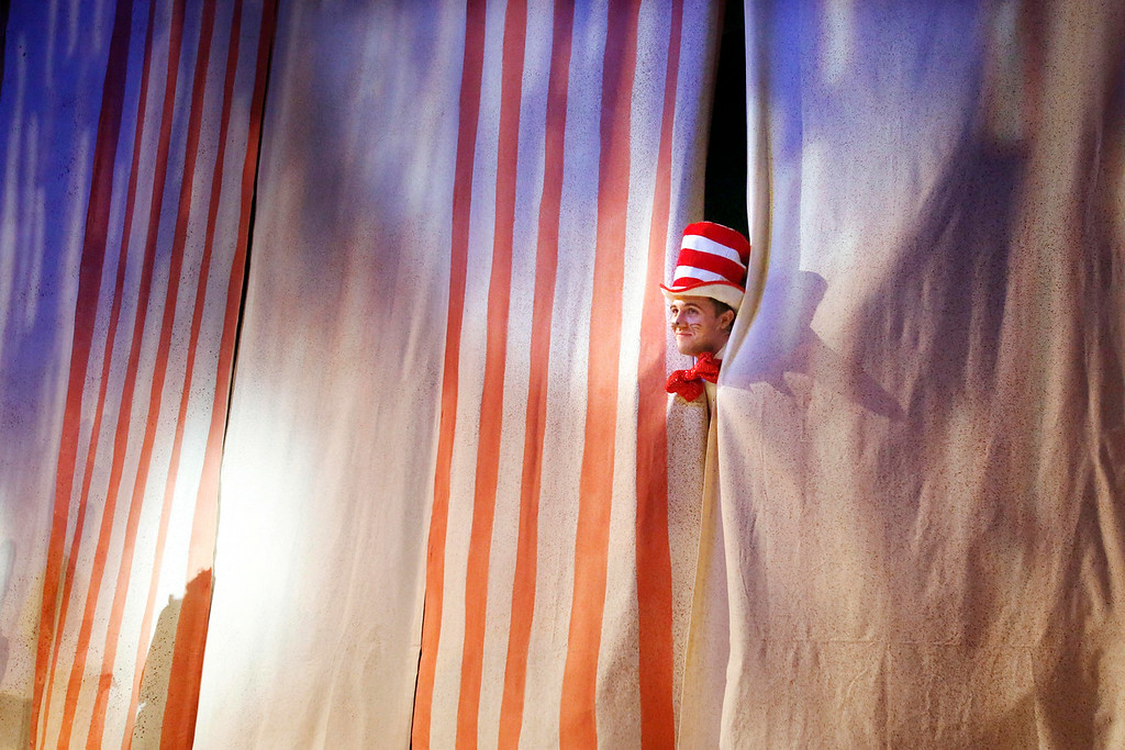. The Cat in the Hat, played by Cody Lee Miller, pops out from the curtain during the final dress rehearsal for Berkshire Theatre Group\'s performance of \'Seussical\' at the Colonial Theatre in Pittsfield. Wednesday, August 6, 2014. Stephanie Zollshan / Berkshire Eagle Staff / photos.berkshireeagle.com