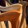 BEN GARVER — THE BERKSHIRE EAGLE<br /> Detail of a cherrywood harp. <br /> West Stockbridge harp maker Michael Costerisan, a longtime woodworker who, for the last five years, has started making harps under the label October Mountain Folk Harps. Costerisan makes folk, or Celtic, harps out of a variety of woods.  The harps all share a round back and a cedar soundboard.