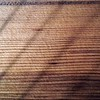 BEN GARVER — THE BERKSHIRE EAGLE<br /> Detail of a cedar soundboard on an October Mountain harp. <br /> West Stockbridge harp maker Michael Costerisan, a longtime woodworker who, for the last five years, has started making harps under the label October Mountain Folk Harps. Costerisan makes folk, or Celtic, harps out of a variety of woods.  The harps all share a round back and a cedar soundboard.