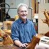 BEN GARVER — THE BERKSHIRE EAGLE<br /> Sam Craig, a woodcarver with a theater background who lives in Hinsdale, poses in his studio Wednesday, August 21, 2019. Craig is a carver who works with cherry and maple.