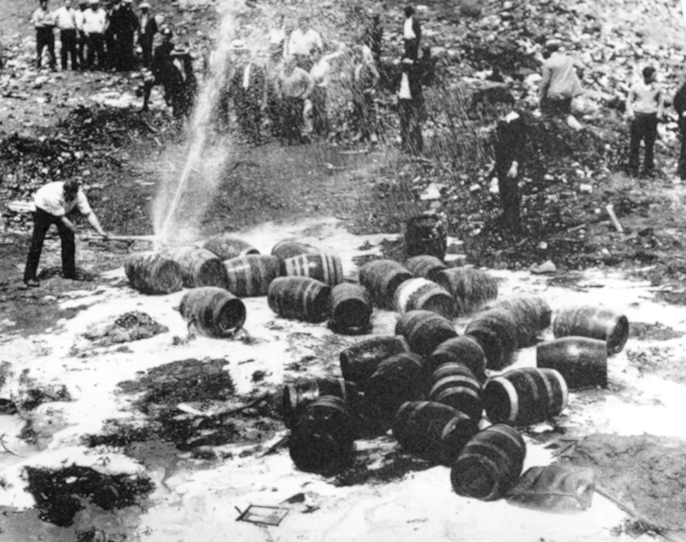 . Beer barrels are destroyed by prohibition agents at a dump in New York City, June 18, 1931. (AP Photo)
