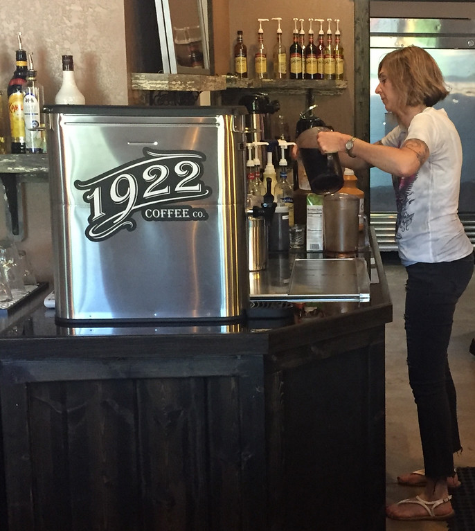 . Lori Richards, the co-owner of the new 1922 Coffee and Brew in Painesville Township, makes an iced coffee for a customer on June 14. (Tawana Roberts - The News-Herald)