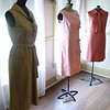 Halston ultra suede dress from the early 1970's, from left, shift style pink cotton floral with bows, Label Luigi of Naples c 1960's {Photo by Kristi  Garabrandt-The News-Herald}