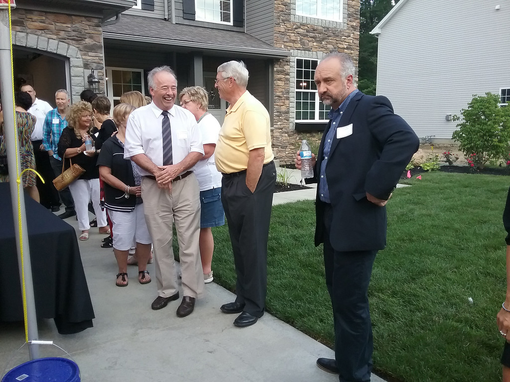 . Among attendees at the 2017 Lake County YMCA Dream House ribbon cutting were, from left, Lake County Commissioner Daniel P. Troy, Willoughby Mayor David E. Anderson and Bo Knez of Knez Homes. (Jean Bonchak - The News-Herald