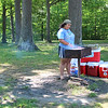 Carmaletta Hinson, who works at Camp Burton, prepares lunch using the outdoor grills at Punderson State Park. (Tawana Roberts - The News-Herald)