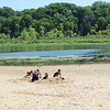 Campers from Camp Burton make sand castles on June 28 at Punderson State Park. (Tawana Roberts - The News-Herald)