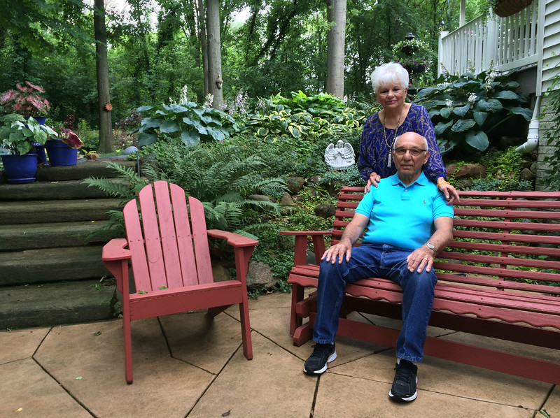Carol Harper - The Morning Journal <br> Joe and Barb Mazzoni pose for a photograph on a patio in their woodland garden at 488 Country Walk, Amherst. The Mazzonis built the home 13 years ago, and asked for advice to form garden spaces flowing from a natural swail of land around the home. The steps are former curbs from the City of Oberlin. Shade loving plants thrive under the trees. The Mazzonis won a June 2016 Awesome Amherst Gardeners Award from Amherst Garden Club.