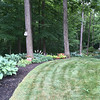 Carol Harper - The Morning Journal <br> Joe and Barb Mazzoni, winners of June 2016 Awesome Amherst Gardeners Award, emphasized a natural flow of their land with woodland gardens full of shade loving plants. Several families of wrens nest in birdhouses on their property each year, they said.