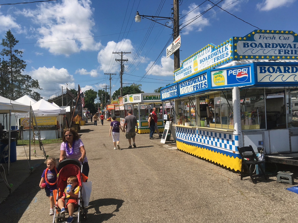 . Bill DeBus � The News-Herald <br> People stroll the midway on July 27 at the Lake County Fair.