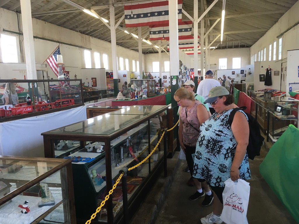 . Bill DeBus � The News-Herald <br> People browse inside the Fine Arts Building on July 27 at the Lake County Fair.