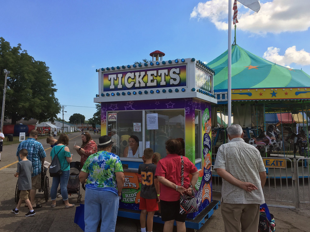 . Bill DeBus � The News-Herald <br> People wait to buy tickets on July 27 at the Lake County Fair.