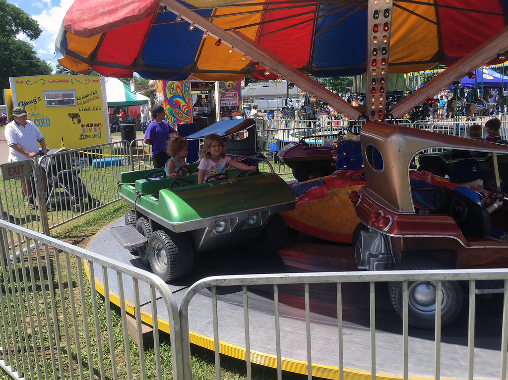 . Bill DeBus � The News-Herald <br> Children ride a kiddie ride on July 27 at the Lake County Fair.