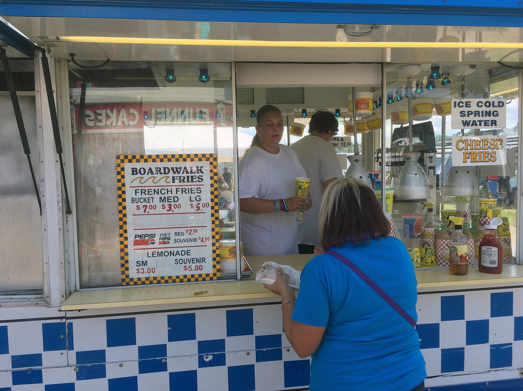. Bill DeBus � The News-Herald <br> A food vendor serves a customer on July 27 at the Lake County Fair.