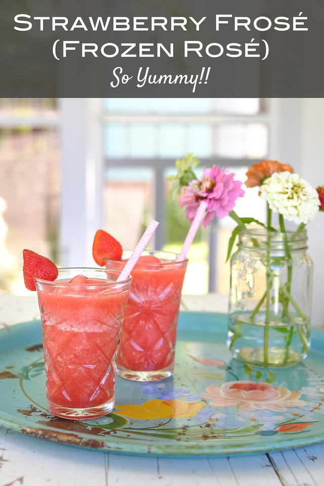 two glasses of frozen rosé on a blue tray with a jar of zinnias with text overlay reading Strawberry Frosé (Frozen Rosé) So Yummy!
