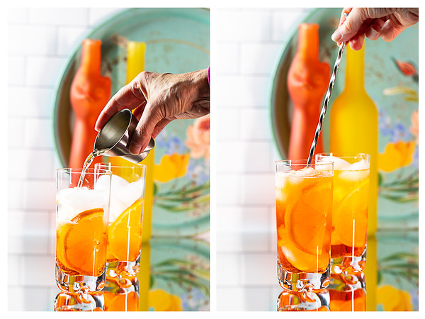 Two photos showing liquid added to glass and then cocktail being stirred.