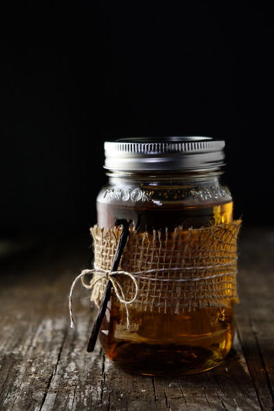Vanilla infused Rum in a jar tied with a vanilla bean