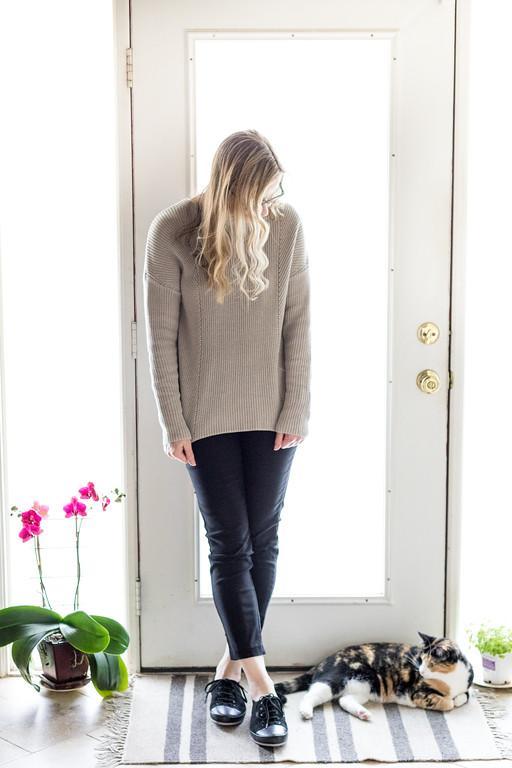 Philosophy sweater, black pants, and black shoes. French Minimalist Wardrobe.