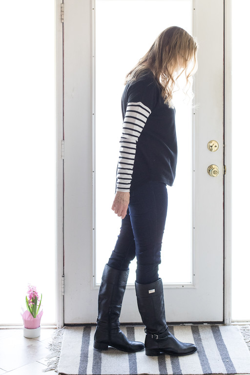 Winter Capsule Wardrobe for Fashion Over 50 - classic black sweater with a fun twist.