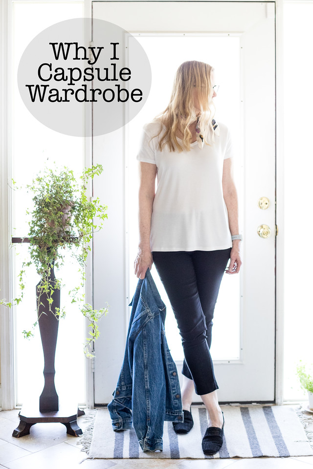A woman in a white t-shirt, black pants and jean jacket in front of a door with text overlay reading