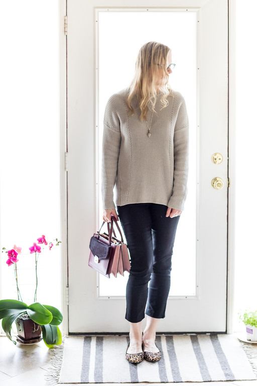 Winter Capsule Wardrobe a neutral sweater, combined with black pants, leopard flats and a kate spade purse.