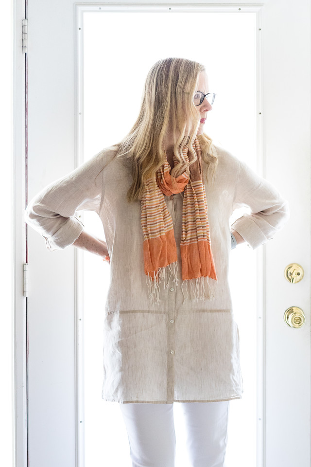 Ivory Linen Tunic with white pants and an orange scarf