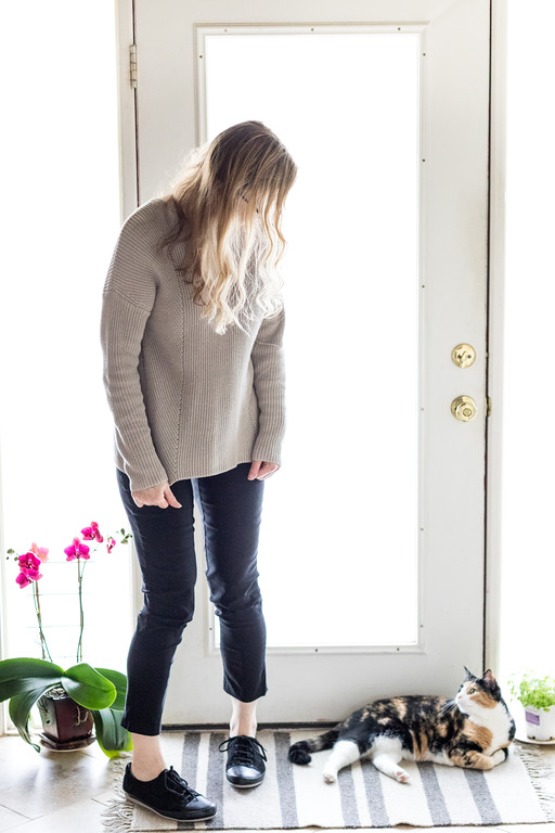 Woman in Philosophy Sweater with black pants, shoes, and kitty cat!