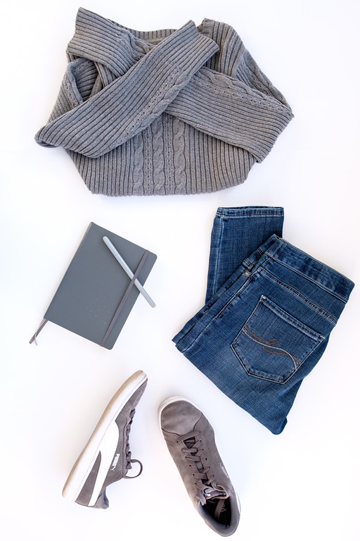 Flat lay of gray Sonoma sweater, Lee jeans, and gray puma suede womens tennies