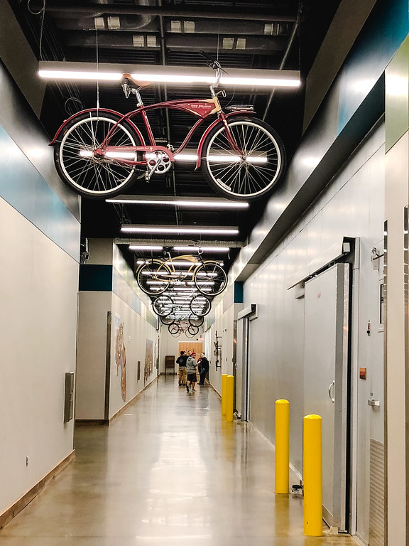 Hallway at New Belgium Brewery with bikes hanging from the ceiling.