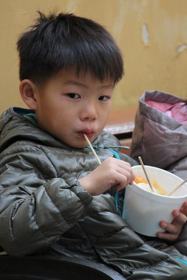 Chinese Boy easting Lunch, Macau