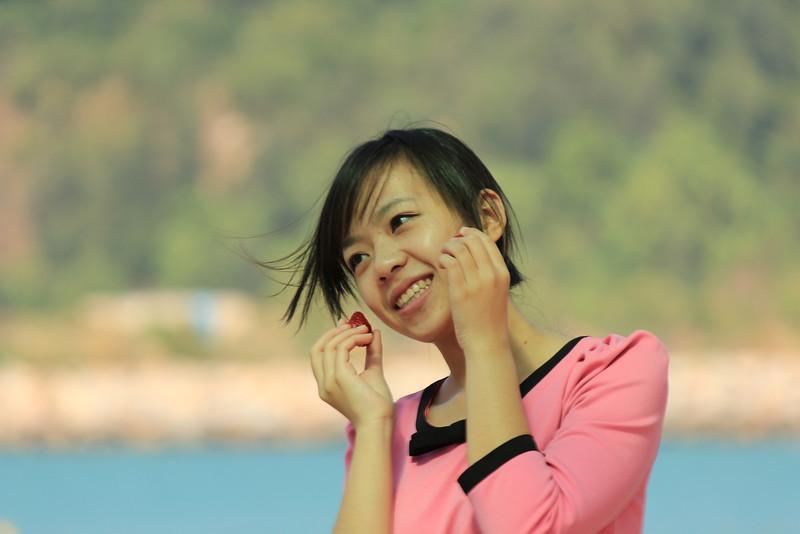 Asian Girl posing with strawberries, Sok Kwu Wan, Lamma Island, Hong Kong
