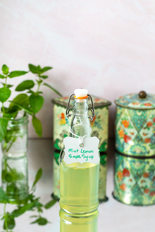 Bottle of pale green liquid, labeled Mint Lemon Simple Syrup.