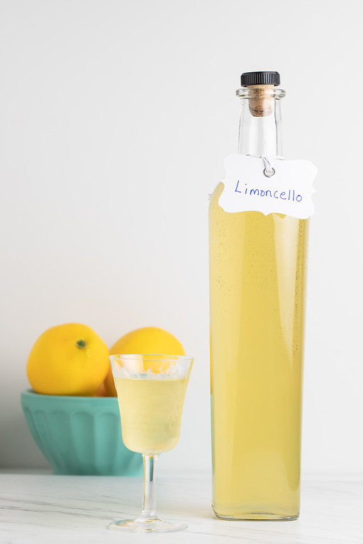 "Bottle of bright yellow liquid with the tag reading ""Limoncello."""