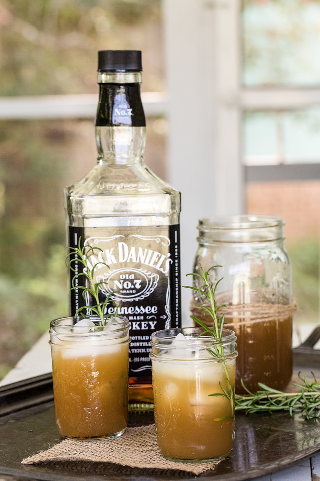 Bottle of Jack Daniels with cocktails in mason jars