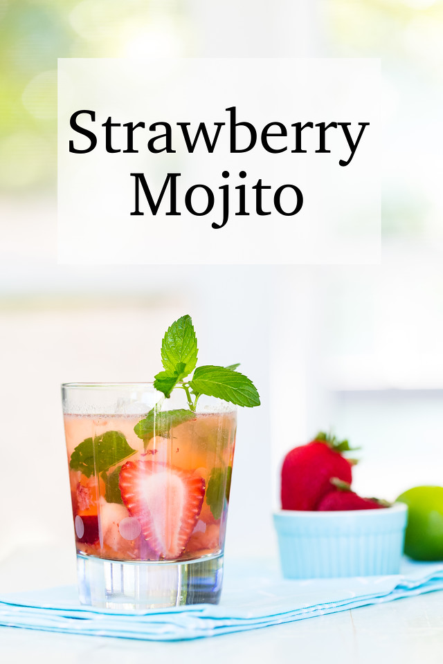 glass filled with a strawberry mojito and the text Strawberry Mojito overlayed