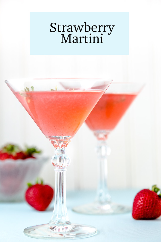 two glasses filled with a pink liquid, strawberries and text overlay reading Strawberry martini