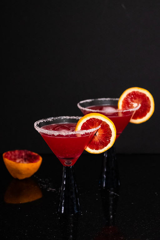 Two glasses of deep red blood orange margaritas.